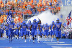 Boise State wide receiver Octavius Evans (1) carries the hammer onto the field before an NCAA college football game against Marshall in Boise, Idaho, Friday, Sept. 6, 2019. (AP Photo/Otto Kitsinger)