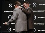 Alabama head coach Nick Saban and Clemson head coach Dabo Swinney pose with the trophy at a news conference for the NCAA college football playoff championship game Sunday, Jan. 6, 2019, in Santa Clara, Calif. (AP Photo/David J. Phillip)