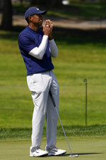 Tiger Woods reacts after missing a putt on the seventh hole during the third round of the PGA Championship golf tournament at TPC Harding Park Saturday, Aug. 8, 2020, in San Francisco. (AP Photo/Jeff Chiu)