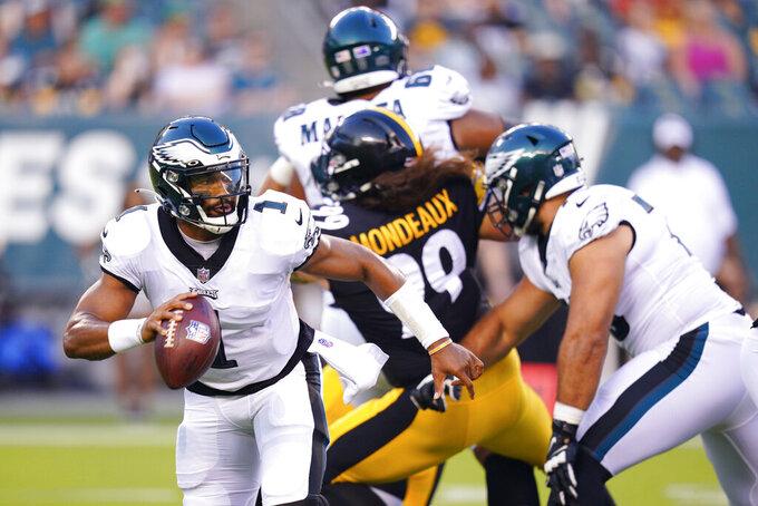 Philadelphia Eagles quarterback Jalen Hurts looks to pass during a preseason NFL football game against the Pittsburgh Steelers Thursday, Aug. 12, 2021, in Philadelphia. (AP Photo/Chris Szagola)