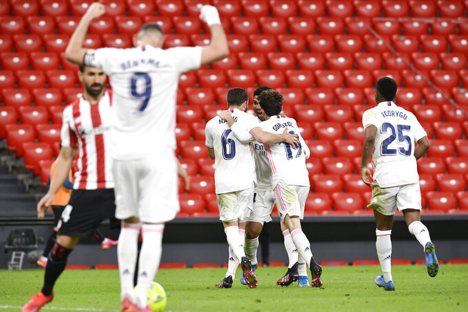 Real Madrid's Karim Benzema, and his fellow teammate celebrate the first goal of his team during Spanish La Liga soccer match between Athletic Bilbao and Real Madrid at San Mames stadium, in Bilbao, northern Spain, Sunday, May 16, 2021. (AP Photo/Alvaro Barrientos)