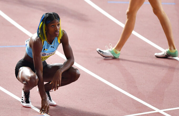 FILE - In this Oct. 3, 2019, file photo, Shaunae Miller-Uibo, of Bahamas, looks at the scoreboard after winning silver in the women's 400-meter final at the World Athletics Championships in Doha, Qatar. Miller-Uibo won gold in Rio with a dive at the finish of the 400 meters. She's diving in at the Tokyo Games with plans to not only defend her title but chase after gold in the 200 meters. (AP Photo/Martin Meissner, File)
