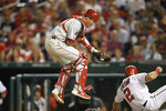 Washington Nationals' Adam Eaton (2) slides home against Philadelphia Phillies catcher Andrew Knapp, left, during the fifth inning of a baseball game, Monday, Sept. 23, 2019, in Washington. Easton scored on the play. (AP Photo/Nick Wass)