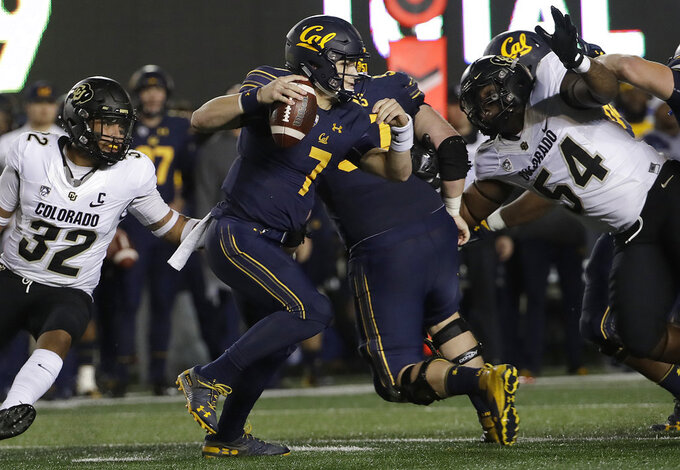 California quarterback Chase Garbers (7) scrambles away from Colorado linebacker Rick Gamboa (32) and defensive end Terrance Lang (54) during the second half of an NCAA college football game in Berkeley, Calif., Saturday, Nov. 24, 2018. California won, 33-21. (AP Photo/Jeff Chiu)