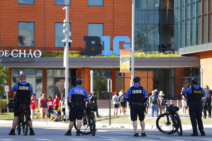 Bike police watch over a parent protest outside of the Big Ten headquarters on Friday, August 21, 2020 in Rosemont. Parents from Ohio State, University of Iowa, and University of Wisconsin, were among those protesting the postponement of the football season and the lack of transparency. (Stacey Wescott/Chicago Tribune via AP)