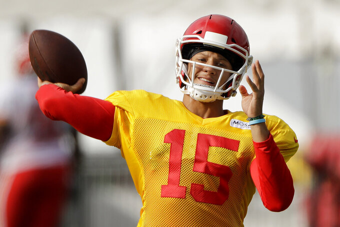 Kansas City Chiefs quarterback Patrick Mahomes throws the ball during NFL football training camp Monday, July 29, 2019, in St. Joseph, Mo. (AP Photo/Charlie Riedel)