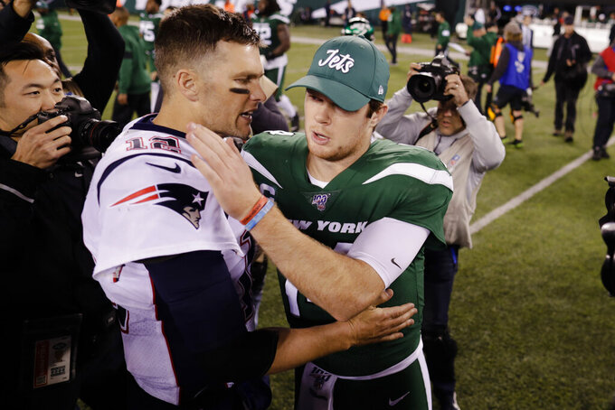 New England Patriots quarterback Tom Brady, left, talks to New York Jets quarterback Sam Darnold after an NFL football game Monday, Oct. 21, 2019, in East Rutherford, N.J. The Patriots won 33-0. (AP Photo/Adam Hunger)