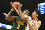 Vermont center Daniel Giddens (2) and Virginia guard Kihei Clark (0) struggle for a rebound during the first half of an NCAA college basketball game Tuesday, Nov. 19, 2019, in Charlottesville, Va. (AP Photo/Steve Helber)