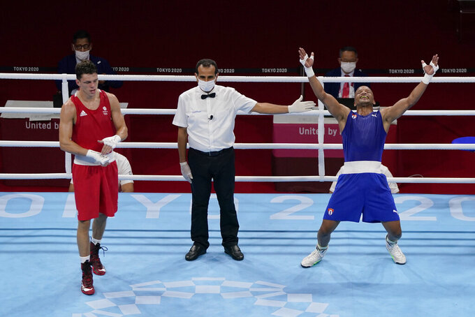 Britain's Pat McCormack left and Cuba's Roniel Iglesias react after their men's welterweight 69-kg boxing match men's welterweight 69-kg boxing match at the 2020 Summer Olympics, Tuesday, Aug. 3, 2021, in Tokyo, Japan. (AP Photo/Frank Franklin II)