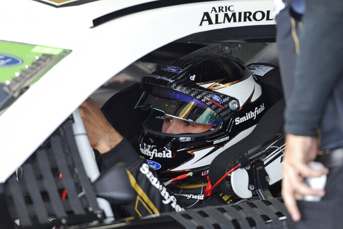 Aric Almirola is seen in his car during practice for Sunday's NASCAR Cup Series auto race at Charlotte Motor Speedway in Concord, N.C., Saturday, Sept. 28, 2019. (AP Photo/Mike McCarn)