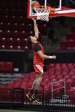 Maryland NCAA college basketball player Anthony Cowan Jr. practices during Media Day, Tuesday, Oct. 15, 2019, in College Park, Md. (AP Photo/Gail Burton)
