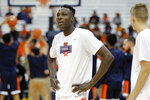 Syracuse's Bourama Sidibe wears a shirt in support of Syracuse women's basketball player Tiana Mangakahia who has announced her cancer diagnosis in Syracuse, N.Y., Wednesday, Nov. 6, 2019. Syracuse players wore the shirts during warm ups before an NCAA college basketball game against Virginia. (AP Photo/Nick Lisi)