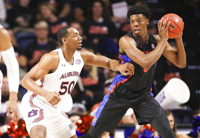Auburn center Austin Wiley (50) guards Florida forward Omar Payne (5) during the first half of an NCAA college basketball game Saturday, Jan. 18, 2020, in Gainesville, Fla. (AP Photo/Matt Stamey)