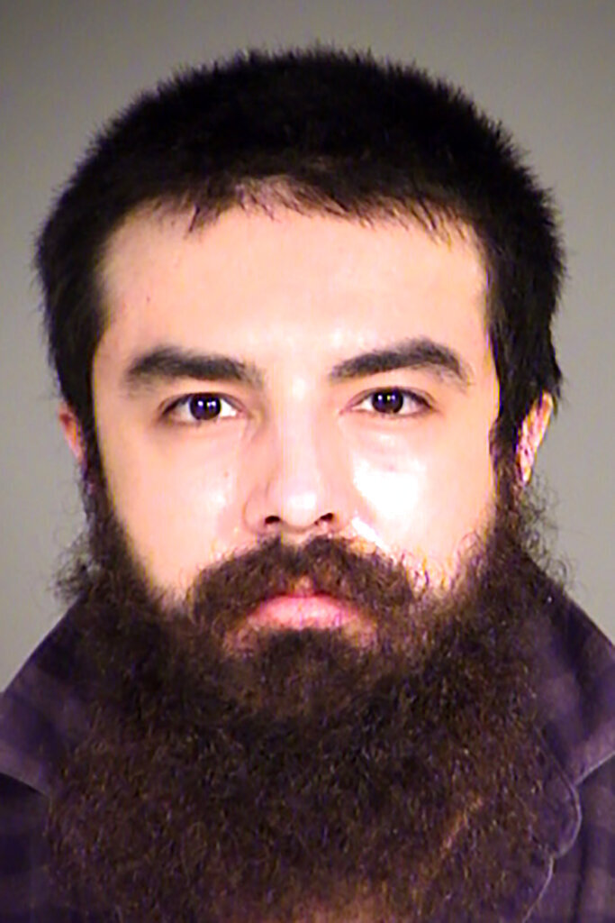 This undated photo provided by the Fond du Lac County, Wis., Sheriff's Office, shows Daniel Navarro, a Mexican American man from Wisconsin charged with homicide as a hate crime because prosecutors say he intentionally crashed his pickup truck into a motorcyclist and killed the man because he was white. (Fond du Lac County Sheriff's Office via AP)
