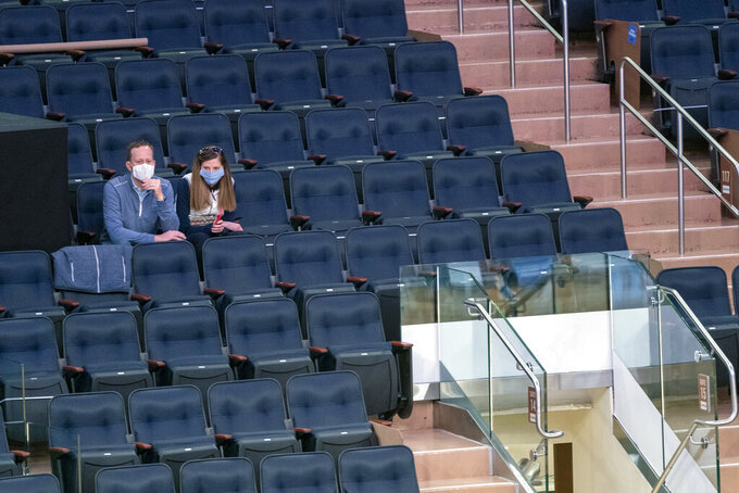 Fans watch the teams warm up before the start of an NCAA college basketball game between Villanova and Georgetown in the quarterfinals of the Big East conference tournament, Thursday, March 11, 2021, in New York. (AP Photo/Mary Altaffer)