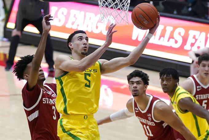 Oregon guard Chris Duarte (5) shoots in front of Stanford forwards Ziaire Williams (3) and Jaiden Delaire (11) during the first half of an NCAA college basketball game in Stanford, Calif., Thursday, Feb. 25, 2021. (AP Photo/Jeff Chiu)