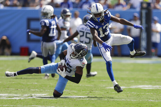 Tennessee Titans cornerback Logan Ryan (26) intercepts a pass intended for Indianapolis Colts wide receiver T.Y. Hilton (13) in the first half of an NFL football game Sunday, Sept. 15, 2019, in Nashville, Tenn. (AP Photo/James Kenney)