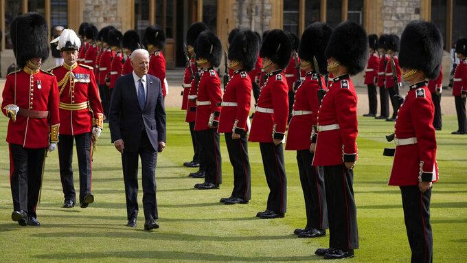 US President Joe Biden inspects a Guard of Honour after arriving to meet Britain's Queen Elizabeth II at Windsor Castle near London, Sunday, June 13, 2021. (AP Photo/Matt Dunham, Pool)