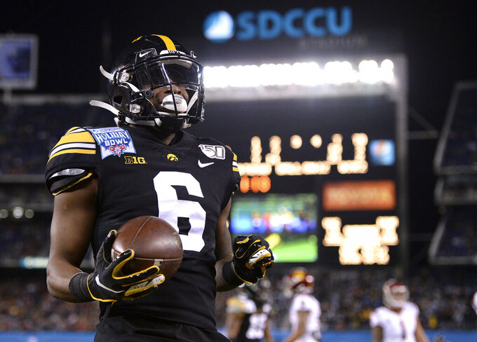Iowa wide receiver Ihmir Smith-Marsette reacts after scoring a touchdown during the first half of the Holiday Bowl NCAA college football game against Southern California, Friday, Dec. 27, 2019, in San Diego. (AP Photo/Orlando Ramirez)