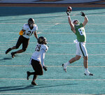 North Texas tight end Jason Pirtle reaches for a pass with Appalachian State defenders Ryan Huff (21) and Brendan Harrington (29) closing in during the inaugural Myrtle Beach Bowl NCAA college football game, Monday, Dec. 21, 2020, at Brooks Stadium in Conway, S.C. (Keith Jacobs/The Sun News via AP)