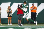New York Jets wide receiver Lawrence Cager catches a pass in the end zone for a touchdown during the first half of an NFL preseason football game against the Philadelphia Eagles Friday, Aug. 27, 2021, in East Rutherford, N.J. (AP Photo/Noah K. Murray)