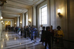 People wait in line to talk to new San Francisco Mayor London Breed inside City Hall Wednesday, July 11, 2018, in San Francisco. The 43-year-old Breed becomes the city's first African American female mayor and she inherits a San Francisco battling homelessness, open drug use and unbearably high housing costs. (AP Photo/Marcio Jose Sanchez)