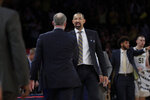 Michigan head coach Juwan Howard, right, shakes hands with Rutgers head coach Steve Pikiell after an NCAA college basketball game Saturday, Feb. 1, 2020, in New York. Michigan won 69-63. (AP Photo/Frank Franklin II)