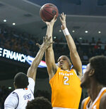 Auburn forward Horace Spencer (0) defends a shot by Tennessee forward Grant Williams (2) during the first half of an NCAA college basketball game Saturday, March 9, 2019, in Auburn, Ala. (AP Photo/Julie Bennett)