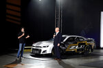 Driver Chase Elliott and Eric Warren, Director, NASCAR Programs with General Motors talk about the Next Gen Camaro that will be used in the 2022 season during the NASCAR media event in Charlotte, N.C., Wednesday, May 5, 2021. (AP Photo/Mike McCarn)