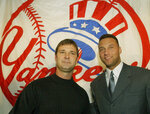 FILE - In this Nov. 4, 2003, file photo, former New York Yankees team captain and newly-named batting coach Don Mattingly, left, poses with current team captain Derek Jeter in New York. After Jeter's group bought the Miami Marlins in late 2017, he jettisoned much of the Marlins' star power, including Giancarlo Stanton, Christian Yelich, Marcell Ozuna and J.T. Realmuto.  But Jeter kept Mattingly, who has been the Marlins' manager since 2016. They have known each other since Jeter was an 18-year-old Yankees prospect and Mattingly was their hitting coach.(AP Photo/Kathy Willens, File)