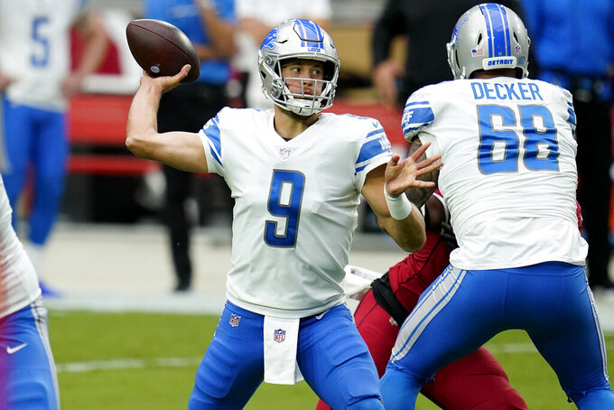 Detroit Lions quarterback Matthew Stafford (9) throws during the first half of an NFL football game against the Arizona Cardinals, Sunday, Sept. 27, 2020, in Glendale, Ariz. (AP Photo/Ross D. Franklin)