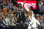 Utah Jazz guard Donovan Mitchell, right, guards Brooklyn Nets forward Taurean Prince (2) in the first half of an NBA basketball game Tuesday, Nov. 12, 2019, in Salt Lake City. (AP Photo/Rick Bowmer)