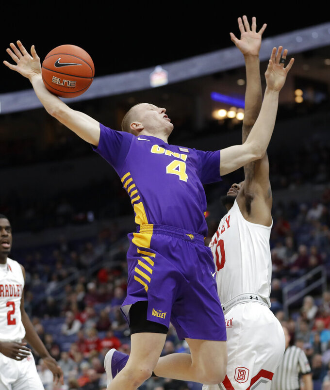 Northern Iowa's AJ Green (4) loses control of the ball as Bradley's Elijah Childs defends during the first half of an NCAA college basketball game in the championship of the Missouri Valley Conference tournament, Sunday, March 10, 2019, in St. Louis. (AP Photo/Jeff Roberson)