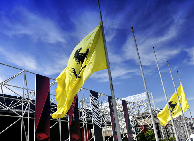 Flags fly at half-mast outside the Ferrari Museum in Maranello, near Modena, Italy, Tuesday, May 21, 2019 on the day Formula One driver Niki Lauda's family issued a statement saying the three-time world champion had passed away at the age of 70. Lauda won the F1 drivers' championship in 1975 and 1977 with Ferrari and again in 1984 with McLaren. (Ferrari SpA via AP)