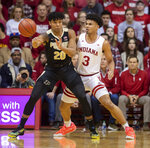 Purdue guard Nojel Eastern (20) makes a pass as Indiana forward Justin Smith (3) defends him during the first half of an NCAA college basketball game, Saturday, Feb. 8, 2020, in Bloomington, Ind. (AP Photo/Doug McSchooler)