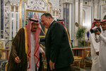 Secretary of State Mike Pompeo leans in to greet Saudi Arabia's King Salman during their meeting at Al-Salam Palace in Jiddah, Saudi Arabia, Monday, June 24, 2019. (AP Photo/Jacquelyn Martin, Pool)