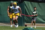 FILE - In this Tuesday, June 8, 2021 file photo, Green Bay Packers' Josiah Deguara runs a drill during an NFL football minicamp in Green Bay, Wis. Green Bay Packers tight end Josiah Deguara says his long recovery from a torn anterior cruciate ligament took a toll on him mentally as well as physically. (AP Photo/Morry Gash, File)