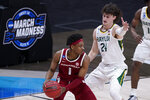 Arkansas guard JD Notae (1) protects the ball from Baylor guard Matthew Mayer (24) during the first half of an Elite 8 game in the NCAA men's college basketball tournament at Lucas Oil Stadium, Monday, March 29, 2021, in Indianapolis. (AP Photo/Darron Cummings)