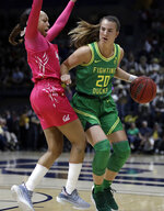 Oregon's Sabrina Ionescu, right, drives the ball against California's Cailyn Crocker in the first half of an NCAA college basketball game Friday, Feb. 21, 2020, in Berkeley, Calif. (AP Photo/Ben Margot)
