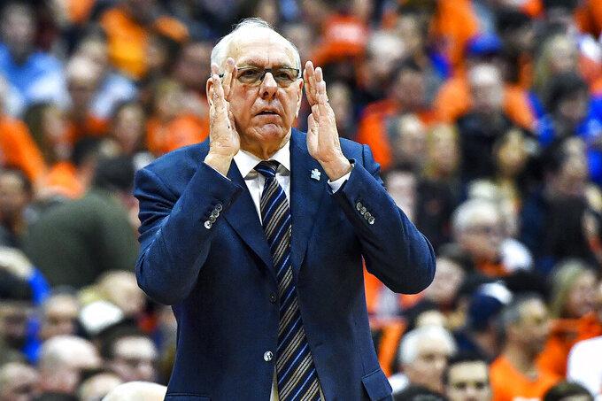 Syracuse head coach Jim Boeheim signals to his players during the first half of an NCAA college basketball game against Duke in Syracuse, N.Y., Saturday, Feb. 1, 2020. (AP Photo/Adrian Kraus)