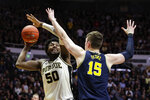 Purdue forward Trevion Williams (50) shoots over Michigan center Jon Teske (15) during the second half of an NCAA college basketball game in West Lafayette, Ind., Saturday, Feb. 22, 2020. (AP Photo/Michael Conroy)
