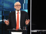 In this photo issued by ITV,  Jeremy Corbyn reacts during the election head-to-head debate live on TV, in Salford, Manchester, England, Tuesday, Nov. 19, 2019.  Prime Minister Boris Johnson and opposition Labour Party leader Jeremy Corbyn are going head-to-head in their first live televised debate Tuesday evening, as the UK prepares for a General Election on Dec. 12. (ITV via AP)