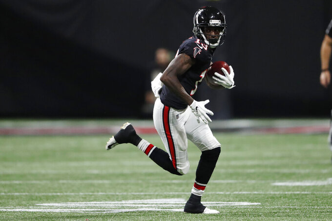 Atlanta Falcons wide receiver Calvin Ridley (18) runs against the New Orleans Saints during the second half of an NFL football game, Thursday, Nov. 28, 2019, in Atlanta. (AP Photo/John Bazemore)
