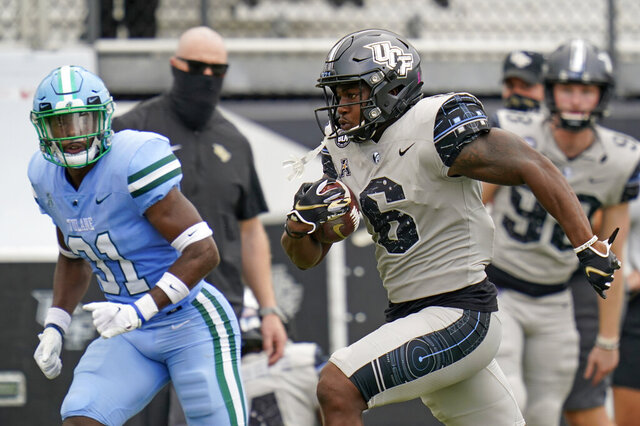 Central Florida wide receiver Marlon Williams (6) runs past Tulane safety Larry Brooks (31) on his way to a 54-yard touchdown on a pass play during the first half of an NCAA college football game, Saturday, Oct. 24, 2020, in Orlando, Fla. (AP Photo/John Raoux)
