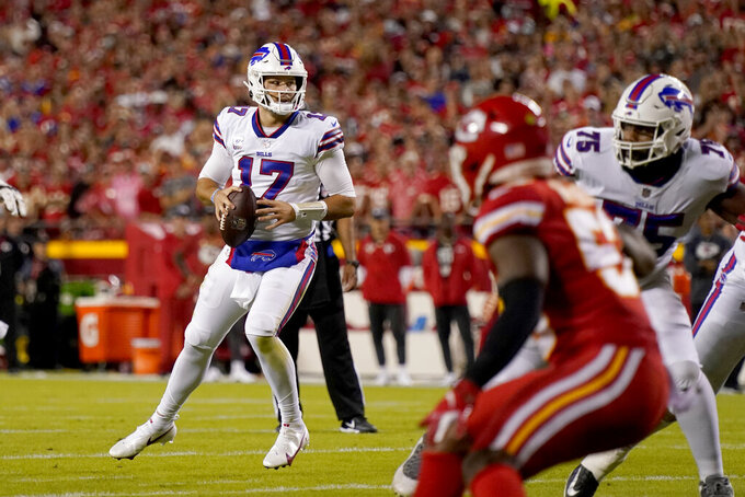 Buffalo Bills quarterback Josh Allen (17) drops back to pass during the first half of an NFL football game against the Kansas City Chiefs Sunday, Oct. 10, 2021, in Kansas City, Mo. (AP Photo/Charlie Riedel)