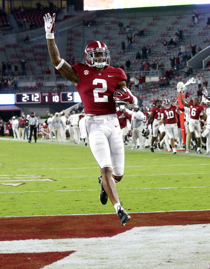FILE  - Alabama defensive back Patrick Surtain II (2) returns an interception for a touchdown against Mississippi State during the second half of an NCAA college football game in Tuscaloosa, Ala., in this Saturday, Oct. 31, 2020, file photo. Alabama is No. 1 in The Associated Press college football poll for the first time this year, Sunday, Nov. 8, 2020, extending its record of consecutive seasons with at least one week on top of the rankings to 13. (Gary Cosby Jr./The Tuscaloosa News via AP)