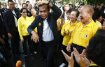 In this Oct. 5, 2018, photo, Thai Prime Minister Prayuth Chan-ocha interacts in dance with members of a Thai-Chinese social group at the Lumpini park in Bangkok, Thailand. Prayuth became prime minister in a very Thai way: He led a military coup. Now after five years of running Thailand with absolute power, he's seeking to hold on to the top job through the ballot box. (AP Photo/Sakchai Lalit)