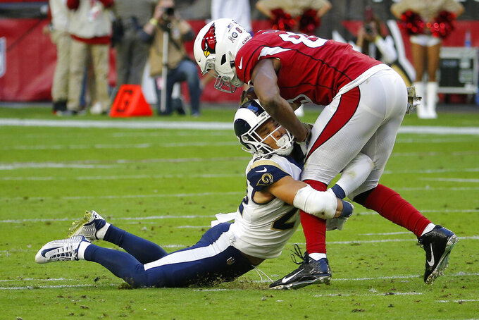 Los Angeles Rams safety Taylor Rapp (24) hits Arizona Cardinals tight end Charles Clay during the first half of an NFL football game, Sunday, Dec. 1, 2019, in Glendale, Ariz. (AP Photo/Rick Scuteri)