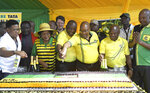 In this photo taken Tuesday, Jan. 8, 2019, former South African president Jacob Zuma, third right, and President Cyril Ramaphosa, third left, cut a birthday cake at the African National Congress' 107th birthday celebrations in Durban, South Africa. Zuma, who was forced from office last year by scandal, is now in the midst of a remarkable makeover, wooed by a ruling party that recognises his enduring appeal to some supporters and is anxious to paper over divisions ahead of elections this year. (AP Photo)