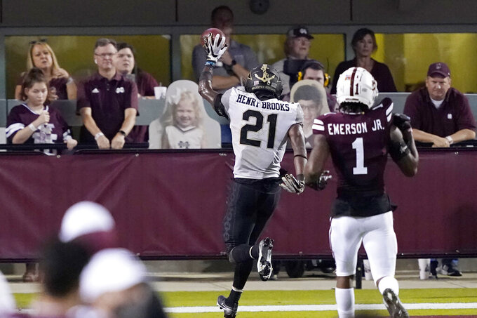 Vanderbilt running back Keyon Henry-Brooks (21) holds the ball aloft as he run past Mississippi State cornerback Martin Emerson Jr., (1) and scores a 27-yard touchdown run during the second half of an NCAA college football game in Starkville, Miss., Saturday, Nov. 7, 2020. (AP Photo/Rogelio V. Solis)